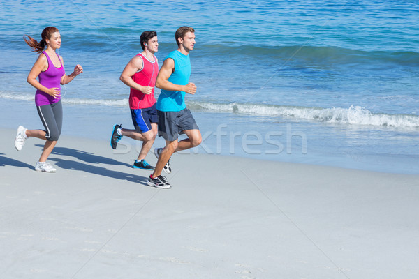 Barátok jogging együtt tengerpart nő tavasz Stock fotó © wavebreak_media