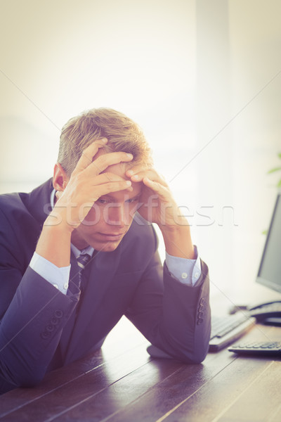 Irritated businessman looking his desk  Stock photo © wavebreak_media