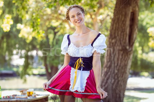 довольно Октоберфест блондинка улыбаясь парка Сток-фото © wavebreak_media