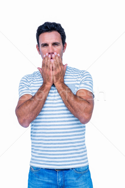 Sad man with his hands on his mouth Stock photo © wavebreak_media