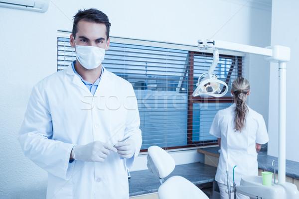 Masculino dentista máscara cirúrgica retrato mulher Foto stock © wavebreak_media