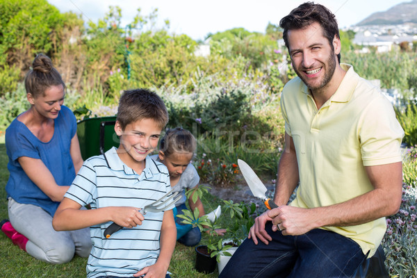 Stock photo: Happy young family gardening together