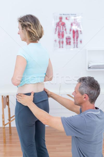 Onderzoeken patiënt Maakt een reservekopie medische kantoor arts Stockfoto © wavebreak_media