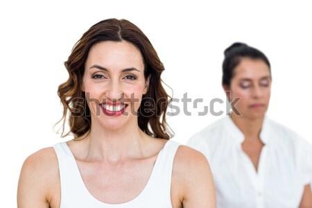 Mujeres sesión loto plantean blanco manos Foto stock © wavebreak_media