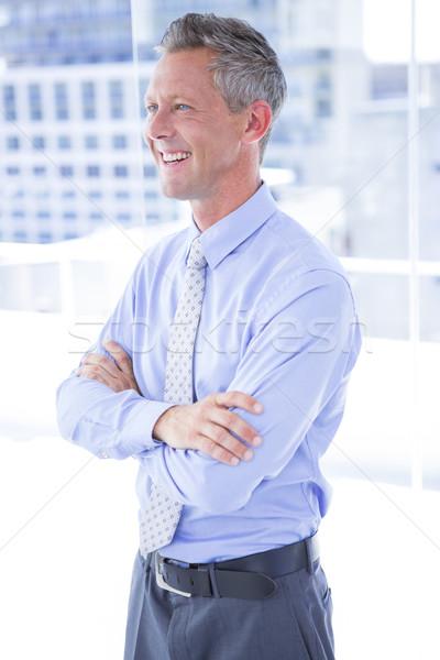 Smiling businessman in the office Stock photo © wavebreak_media