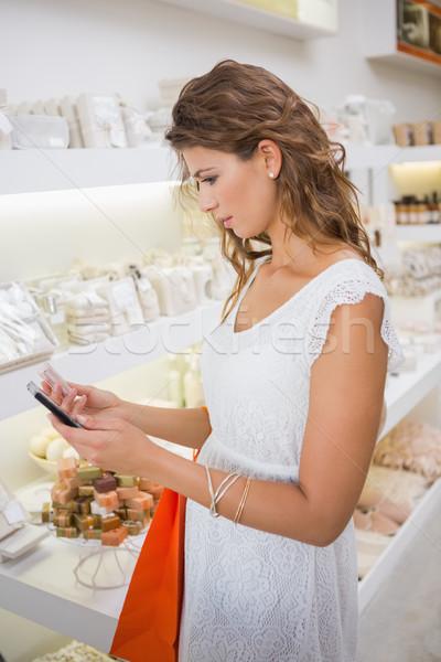Woman looking at herself in handheld mirror Stock photo © wavebreak_media