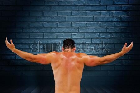 Muscular man punching in the air Stock photo © wavebreak_media