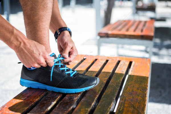 Athletic man tying his shoelaces on the bench Stock photo © wavebreak_media