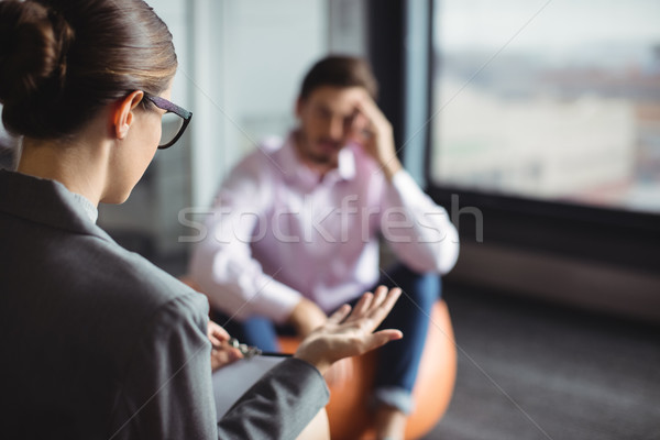 Counselor interacting with unhappy man Stock photo © wavebreak_media