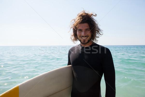 Mosolyog szörfös szörfdeszka áll tengerpart part Stock fotó © wavebreak_media