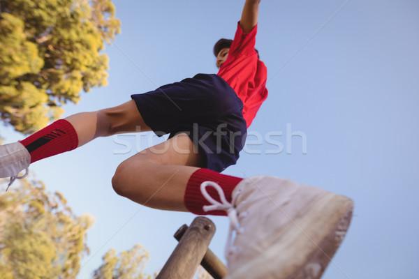 определенный мальчика прыжки препятствие загрузка лагерь Сток-фото © wavebreak_media