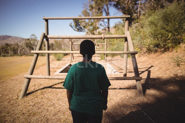 Rear view of boy looking at outdoor equipment during obstacle course Stock photo © wavebreak_media