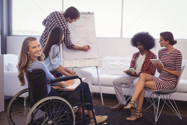Disabled female executive with team planning in creative office Stock photo © wavebreak_media