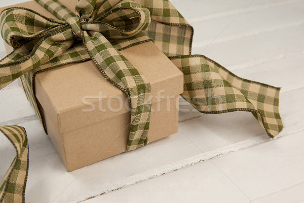 Tied gift box on wooden plank Stock photo © wavebreak_media