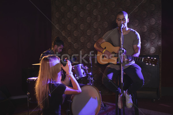 Woman photographing male performer in nightclub Stock photo © wavebreak_media