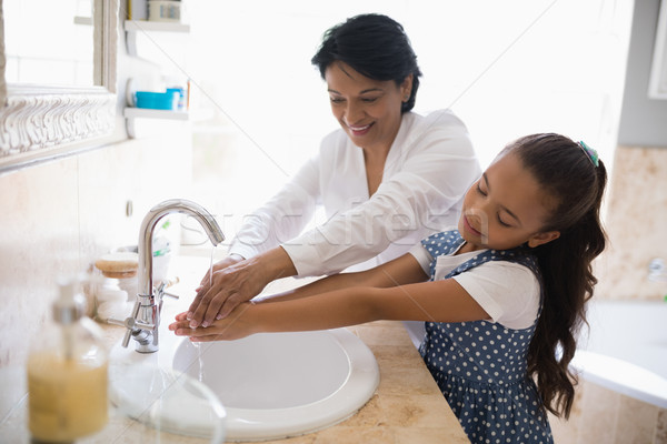 Grandmother and granddaughter washing hands Stock photo © wavebreak_media