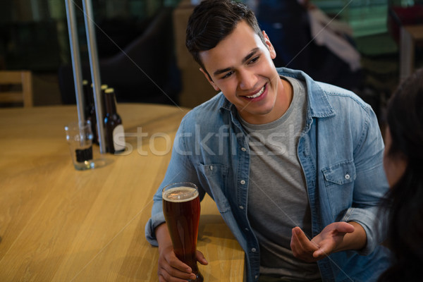 Smiling man talking to friend at bar Stock photo © wavebreak_media