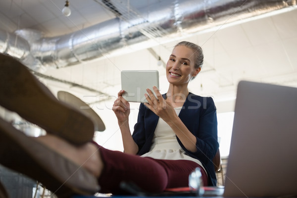 Stock photo: Portrait of businesswoman using digital tablet in office