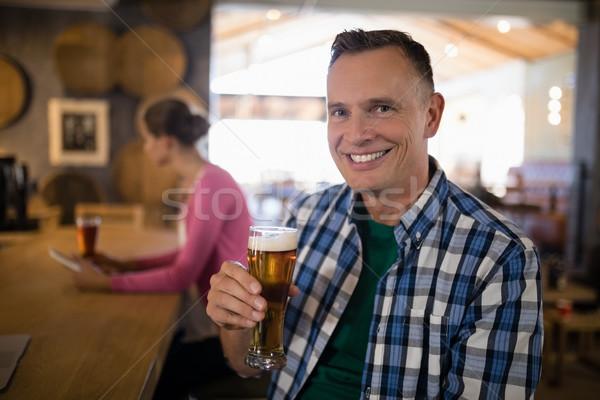 Portré mosolyog férfi üveg sör bár Stock fotó © wavebreak_media