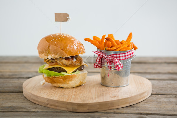 Hamburger by french fries in container on cutting board Stock photo © wavebreak_media