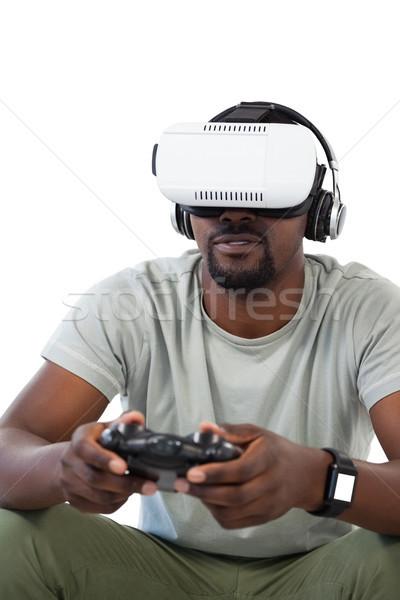 Man using virtual reality headset and playing video game Stock photo © wavebreak_media