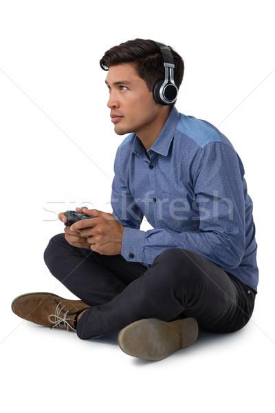 Stok fotoğraf: Tam · uzunlukta · işadamı · oynama · video · oyunu · beyaz · kulaklık