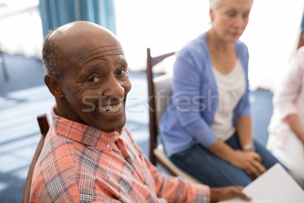 High angle portrait of smiling senior man sitting with females Stock photo © wavebreak_media