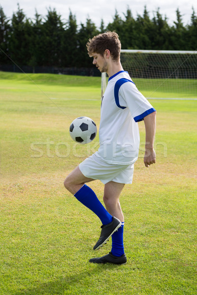 Side view of soccer player playing with ball Stock photo © wavebreak_media