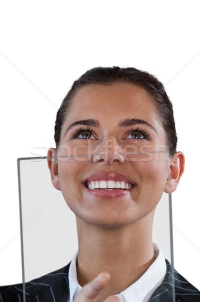 Közelkép mosolyog üzletasszony felfelé néz üveg interfész Stock fotó © wavebreak_media