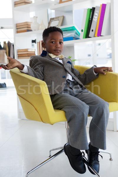 Full length portrait of businessman sitting on armchair Stock photo © wavebreak_media