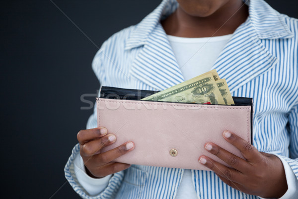 Midsection of businesswoman holding purse with paper currency Stock photo © wavebreak_media