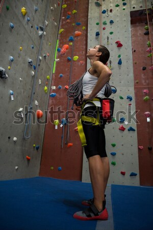 Friends talking while standing by climbing wall at gym Stock photo © wavebreak_media