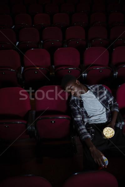 Annoiato uomo popcorn dormire teatro film Foto d'archivio © wavebreak_media