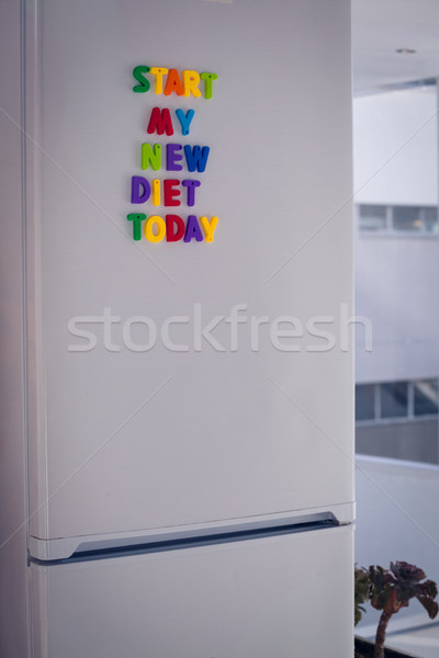 Start my new diet today on refrigerator by office Stock photo © wavebreak_media