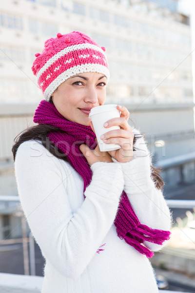 Smiling woman drinking from white cup Stock photo © wavebreak_media
