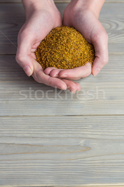 Woman showing handful of milled seed Stock photo © wavebreak_media