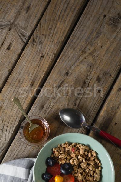 Fruits céréales jar serviette drap table en bois Photo stock © wavebreak_media
