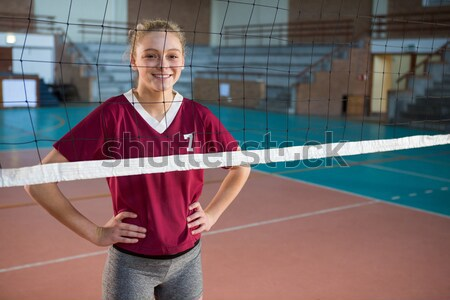 Smiling coach standing in the volleyball court Stock photo © wavebreak_media