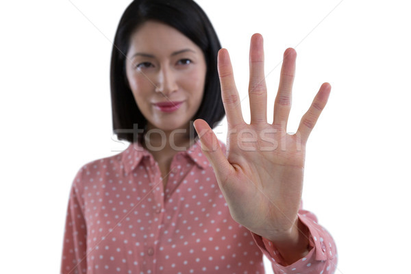 Woman pretending to touch an invisible screen Stock photo © wavebreak_media
