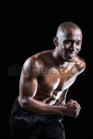 Gespierd man glimlachend lopen zwarte gelukkig Stockfoto © wavebreak_media