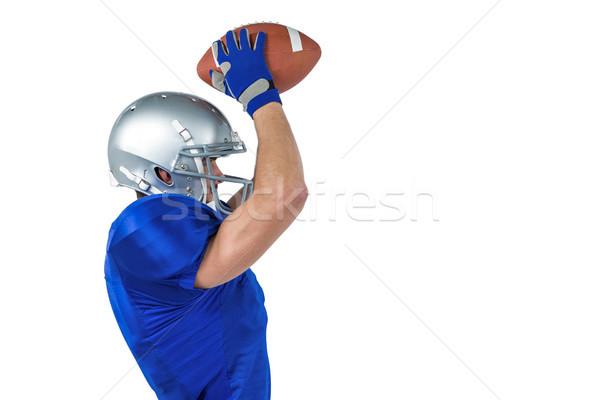 Porfile view ofAmerican football player catching ball Stock photo © wavebreak_media