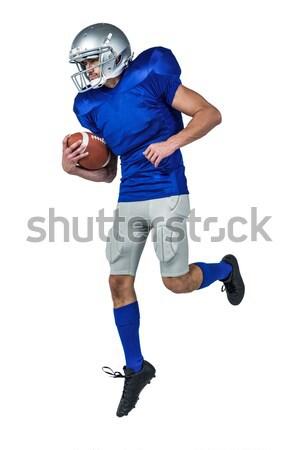 Portré amerikai futballista tart labda teljes alakos Stock fotó © wavebreak_media