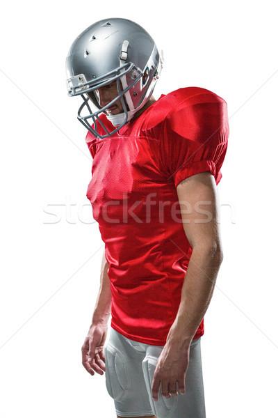 Americano futbolista rojo mirando hacia abajo blanco hombre Foto stock © wavebreak_media