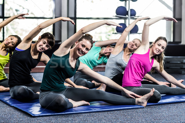 Fit smiling group doing stretching Stock photo © wavebreak_media