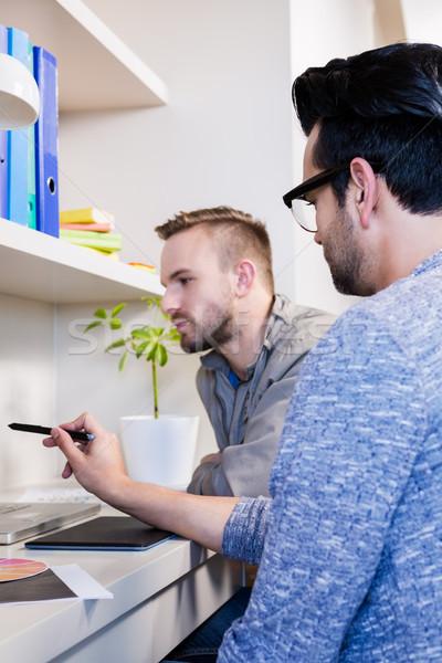 Komoly homoszexuális pár laptopot használ iroda férfi Stock fotó © wavebreak_media