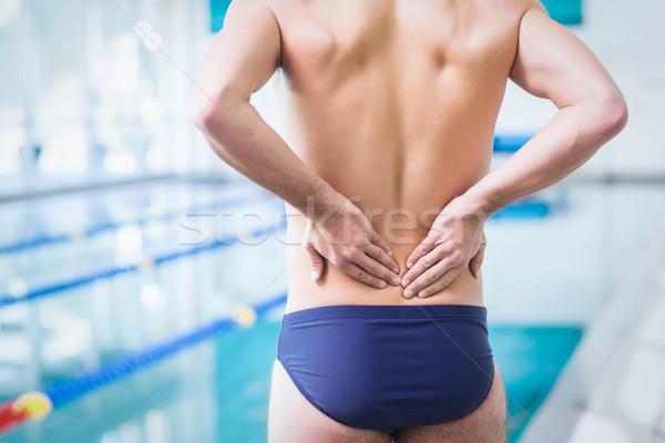 Encajar hombre atrás dolor piscina sexy Foto stock © wavebreak_media