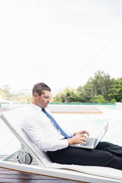 Smarty dressed man using laptop Stock photo © wavebreak_media