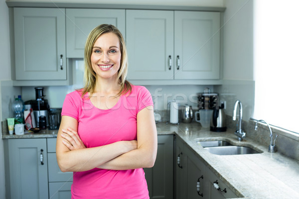 Pretty blonde woman standing in the middle of her kitchen Stock photo © wavebreak_media