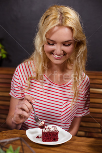 Smiling blonde enjoying a pastry Stock photo © wavebreak_media