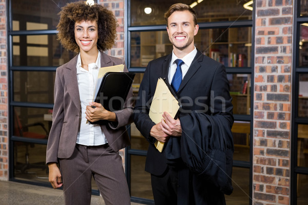 Lawyer and businesswoman standing near library with documents Stock photo © wavebreak_media